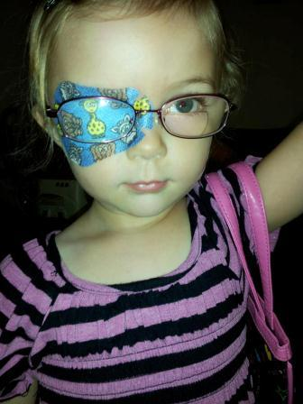 little girl with eye patch